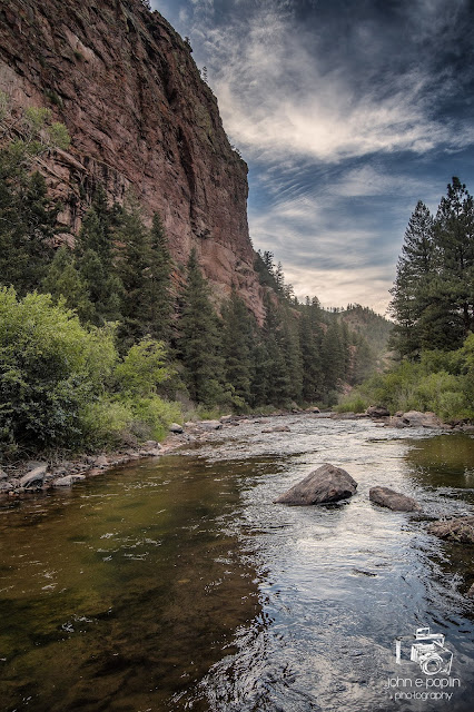The Platte River flows through a Colorado canyon on a summer afternoon.