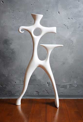 white resin sculptural valet stand
