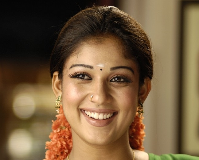 Nayantara Gorgeous Face Close Up Stills In Green Saree