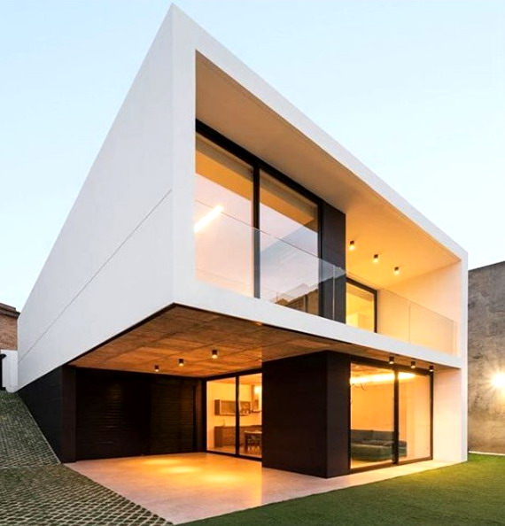 rumah minimalis modern relling kaca