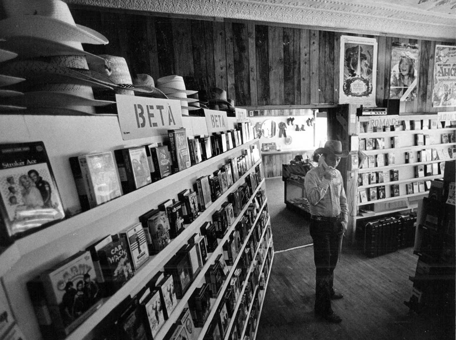 In Castle Rock, Colorado a man answers the phone in the video rental section of his store – including Betamax. 1984.
