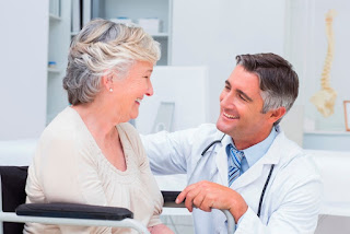 Doctor laughing at old woman