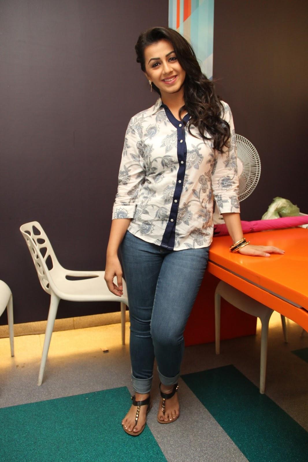 Actress Nikki Galrani Stills In Blue Shirt Jeans