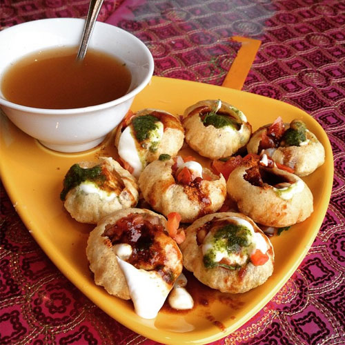 Decorating 8 Golgappa (panipuri) with Red sweet Sauce in plate