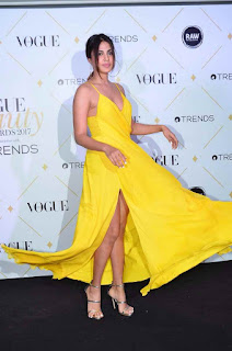 Rhea Chakraborthy in a Yellow Deep neck Sleeveless Leg Split gown at Vogue beauty Awards 2017