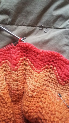 I'm finally binding off Sarah's knitted orange blanket.