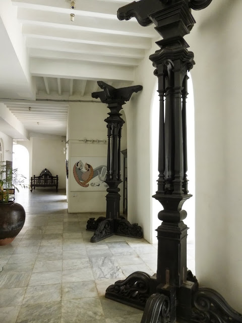 Falaknuma Palace Images: The front porch with giant columns of dark wood