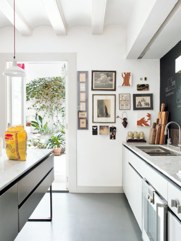 A gallery wall in the kitchen adds personality.