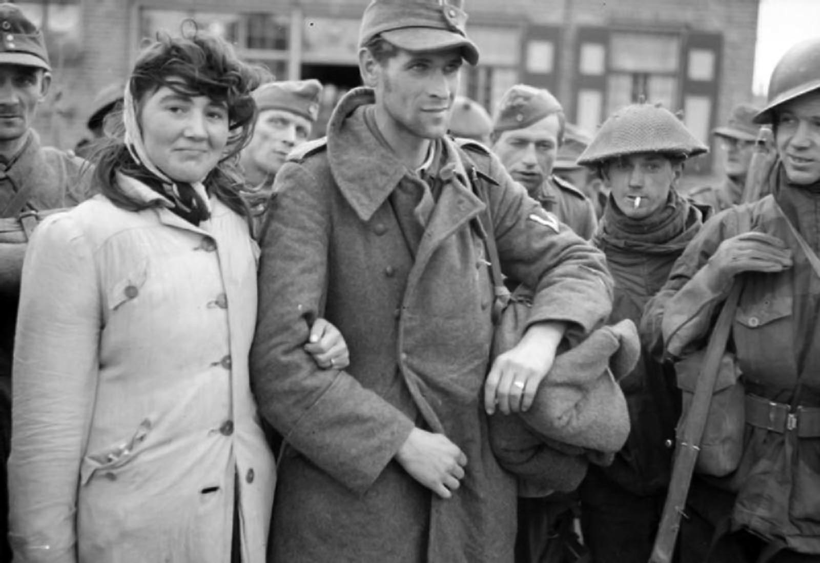 Amongst the prisoners taken at Walcheren was Dutch woman along with her husband, a German soldier, whom she refused to leave. November 1944.