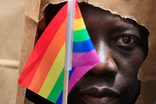 man holding rainbow flag