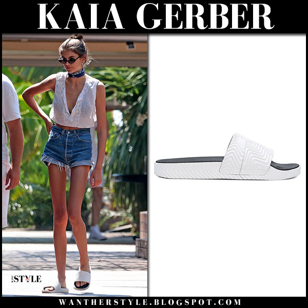 04cd1ea02 Kaia Gerber in denim shorts and white Adidas sandals model summer style  july 27