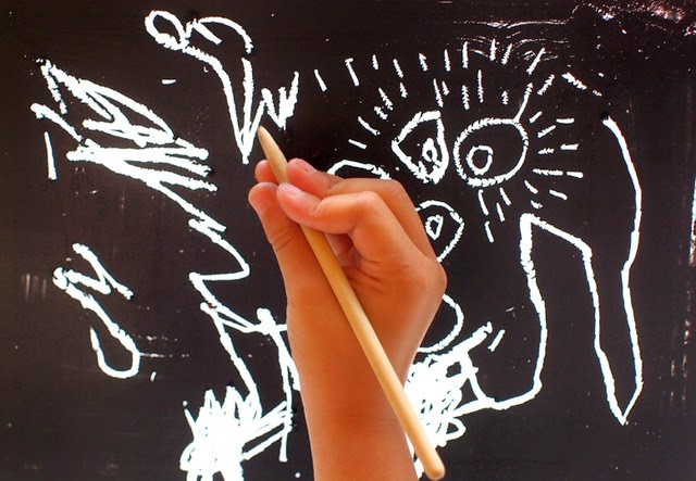 boy using homemade diy scratchboard