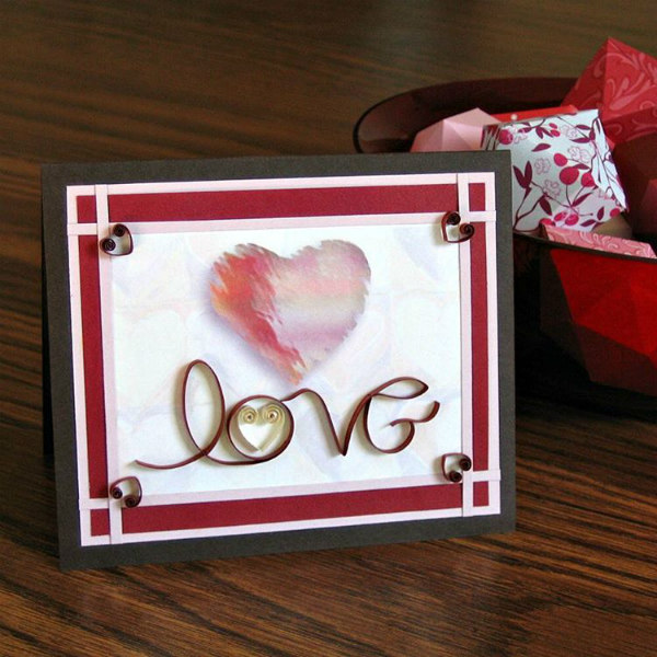 Valentine card with quilled cursive lettering spelling love