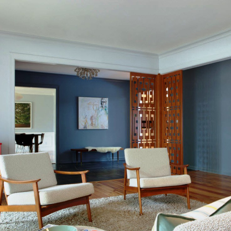 Interior with part light blue and dark blue walls and white ceiling