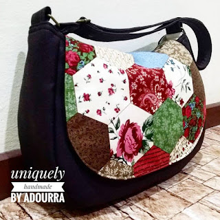 This is the matching curvy sling bag ordered with the previous wallet. Love  the combo and the hexy floral print. The bag has long adjustable strap 84a27d6f89