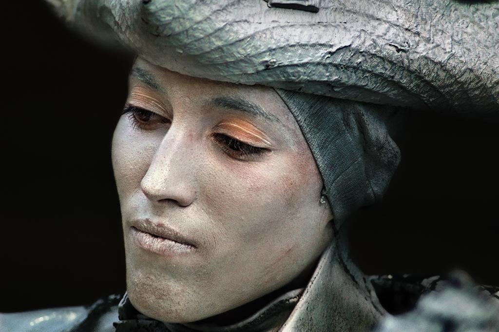 Human statue wearing pirate costume in Barcelona