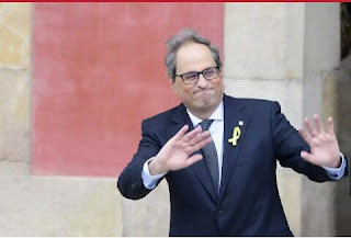 The new elected Catalan regional president Quim Torra waves