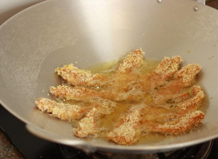 frying chicken tenders in a wok for katsu