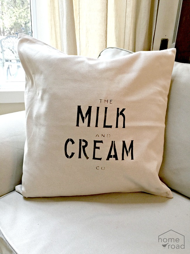 Stenciled Milk and Cream farmhouse pillow covers.