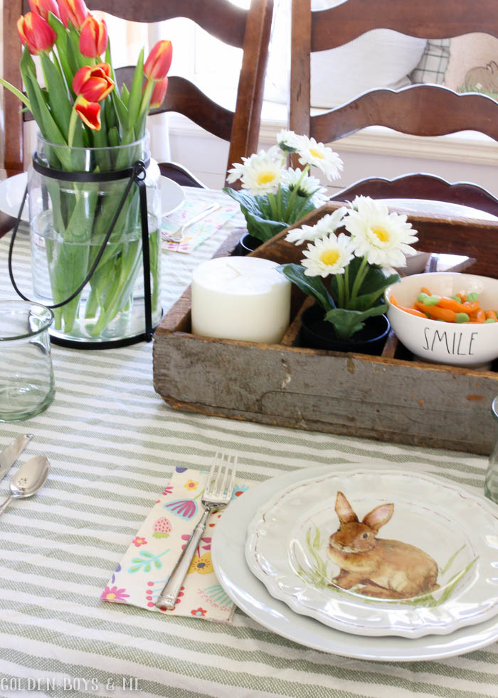 Spring table setting with striped throw used as tablecloth