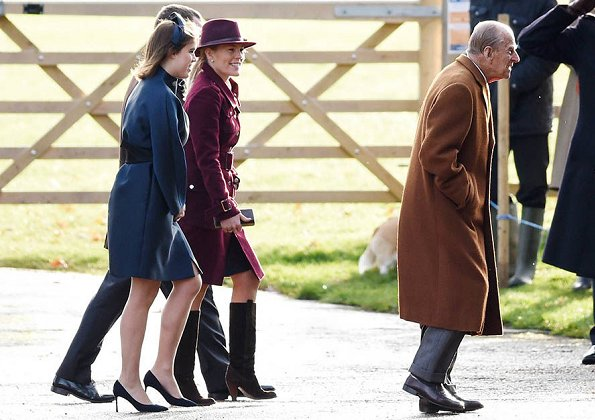 Queen Elizabeth, Countess Sophie of Wessex, Lady Louise Windsor, Princess Anne, Princess Eugenie. Princess Beatrice wore Burberry detachable rib knit collar cashmere coat