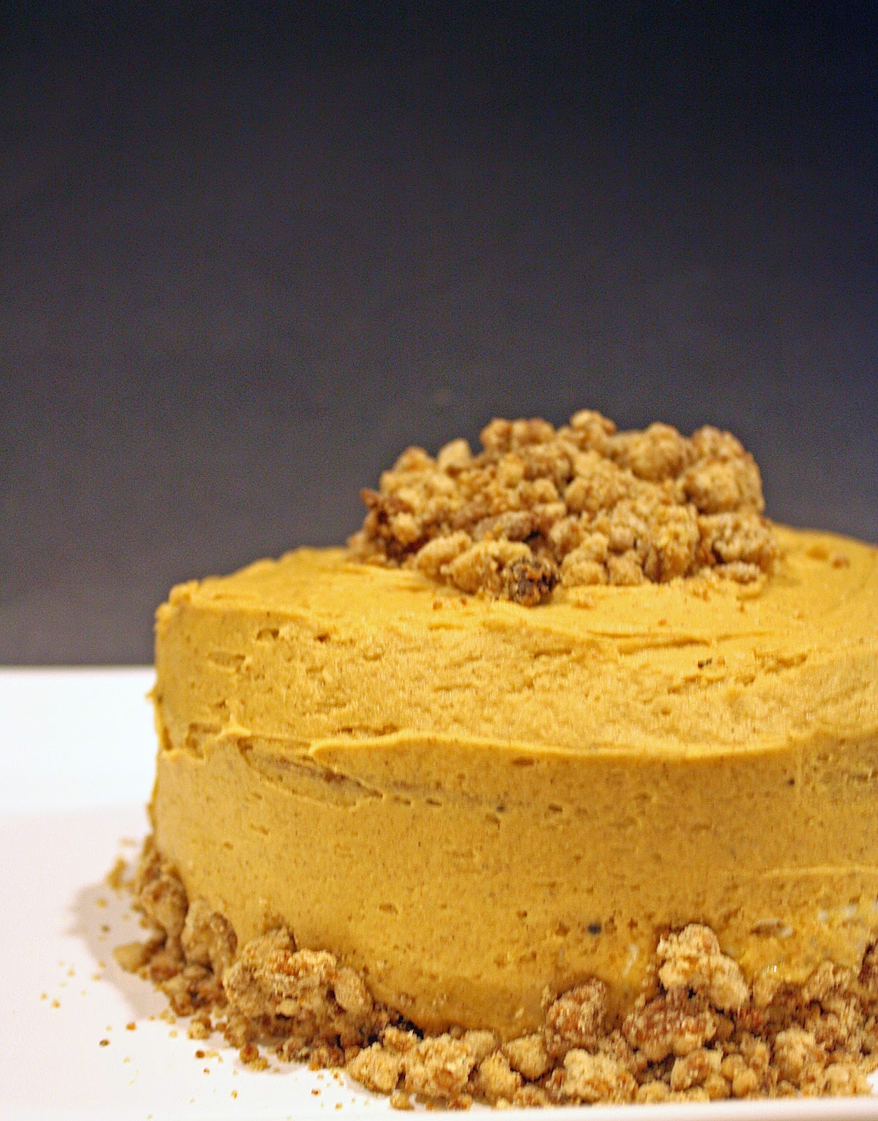 Vegan maple gingerbread layer cake with cheesecake filling and spiced crumb