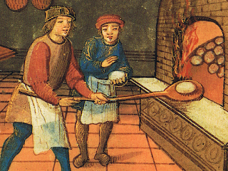 A mediaeval baker and apprentice