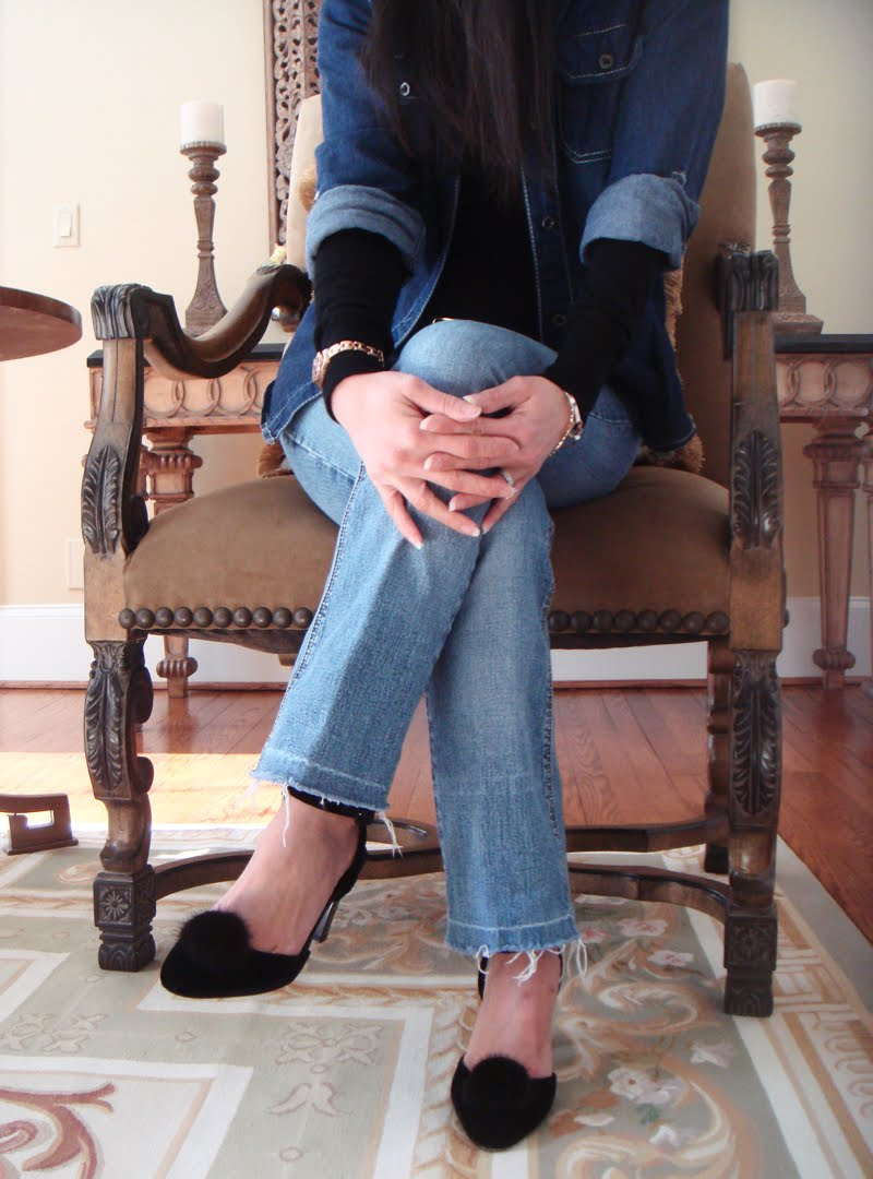 Denim On Denim Outfit Seated in same chair, showing the lower part of the body.