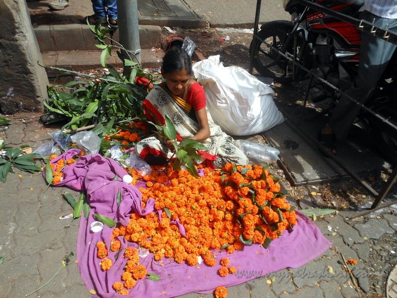 A flower seller, Ganesh Chaturthi Day 1 Ganesh Sthapana Mumbai