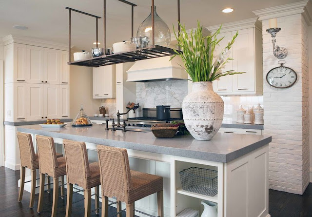 pot rack over island exposed white brick