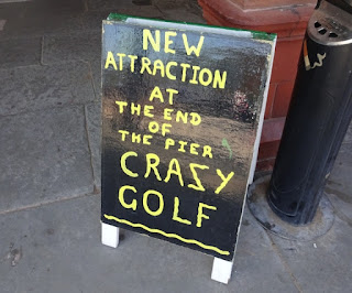Sign for the Crazy Golf course on Saint Annes Pier
