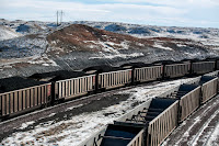 A 2014 photo showing rail cars filled with coal in Wyoming and sprayed with a topper agent to suppress dust. (Credit: Ryan Dorgan/Casper Star-Tribune, via Associated Press) Click to Enlarge.
