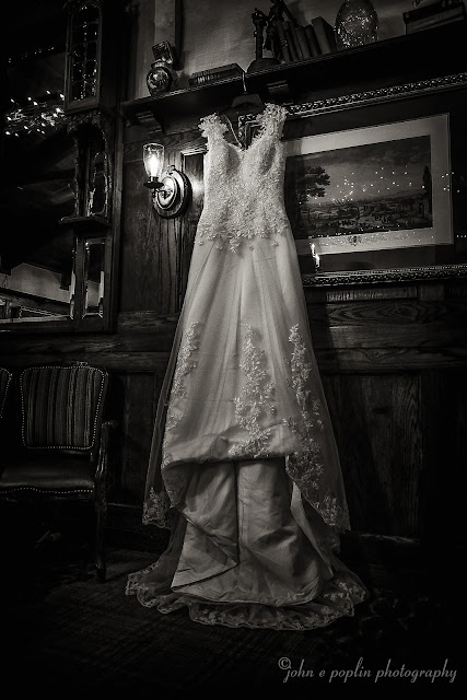 stunning black and white photo of a wedding dress at The Briarwood Inn in Colorado