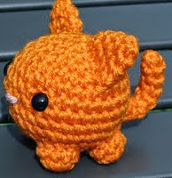 http://www.ravelry.com/patterns/library/modified-roly-poly-cat-amigurumi