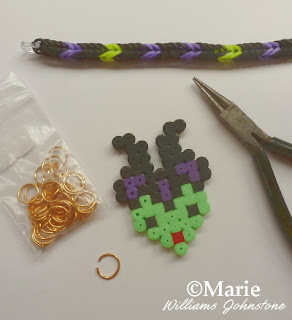 Adding a perler hama bead charm to a rubber band bracelet design