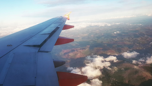 airplane wing for booking the cheapest flights