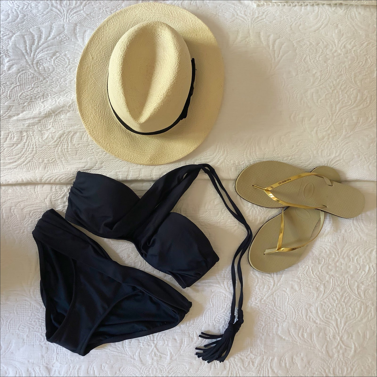 my midlife fashion, coco bay, marks and spencer handwoven panama hat, seafolly indigo wrap front bandeau bikini top, seafolly indigio twist band pant, havaianas light gold you metallic flip flops