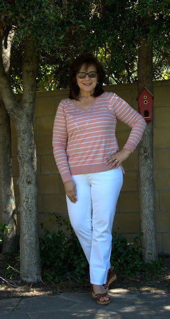 white jeans and pink striped sweater
