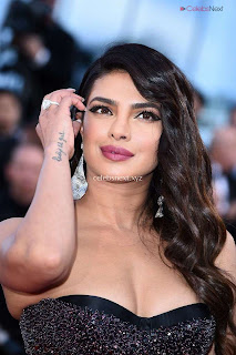 Priyanka Chopra Rocks the Rocketman Screening Cannes ina Sizzling Dark Gown .XYZ Exclusive 05