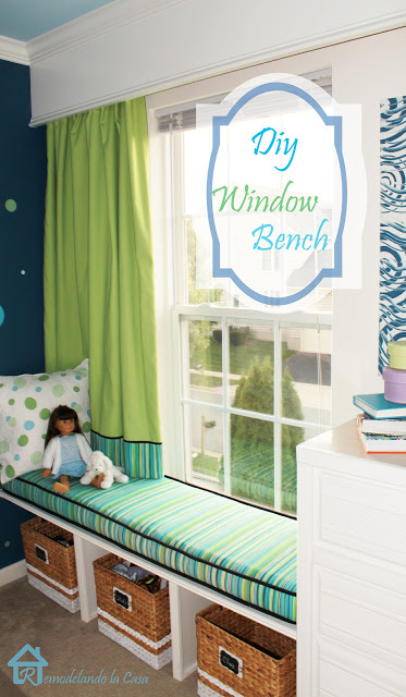 green and blue girl's room with window bench