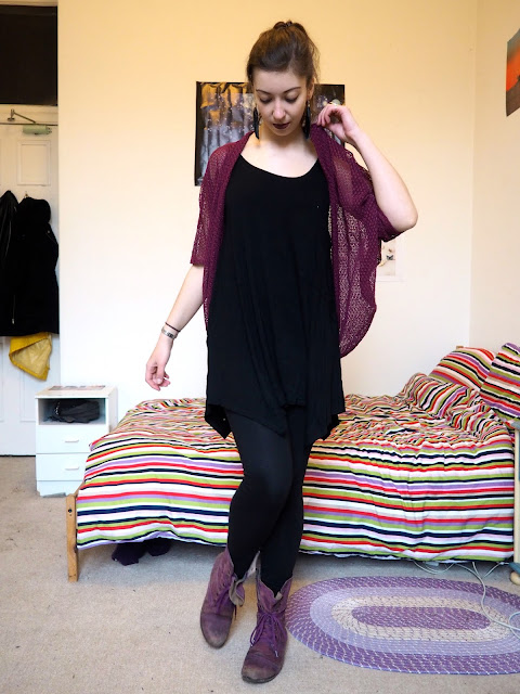 Pull the Lever | Disneybound Yzma outfit of black slouch dress, leggings, pink knit cardigan, and purple combat boots