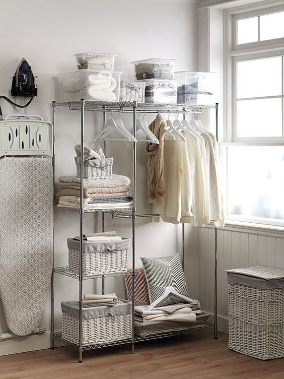 Centros de lavado y planchado en espacios reducidos for Cesto ropa plancha