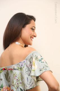 Actress Pragya Jaiswal Stills in Floral Dress at turodu Interview  0068.JPG