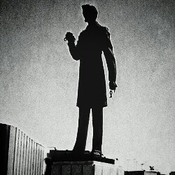 Monochromome Abraham Lincoln statue from Tijuana holding chains