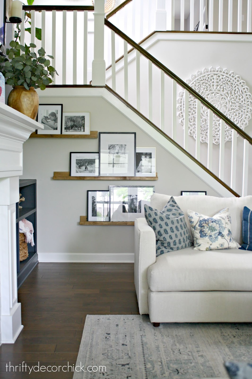 DIY picture ledges under stairs