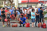 People wait in line to purchase gas in Arecibo, northwestern Puerto Rico, in the aftermath of Hurricane Maria on Sept. 22, 2017. (Credit: Hector Retamal/Getty Images) Click to Enlarge.