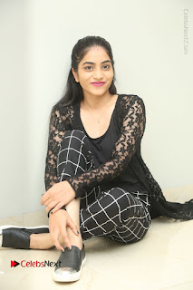 Actress Punarnavi Bhupalam Stills in Black Dress at Pittagoda Press Meet  0119.JPG