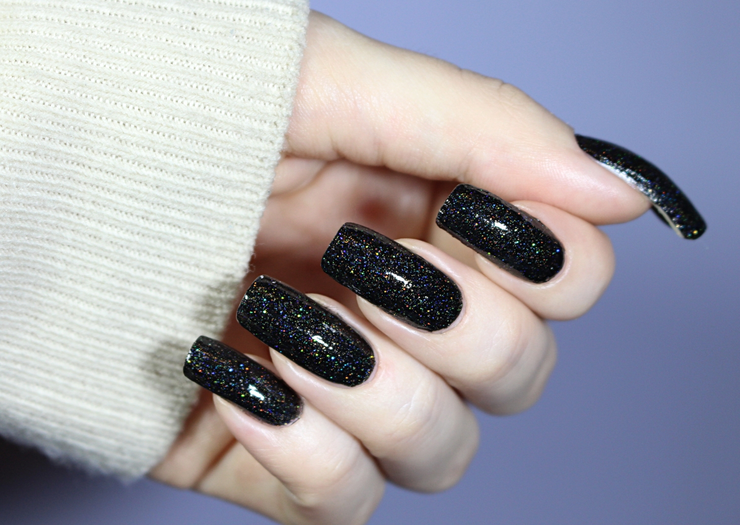 black holographic manicure close up picture