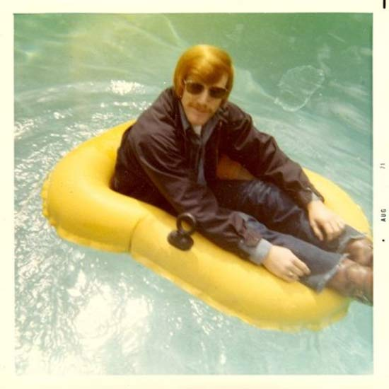 1970s Dads - the original hipsters. Dad in jeans, boots, jacket and sunglasses sitting in a small yellow raft in the pool. The New Dad. marchmatron.com