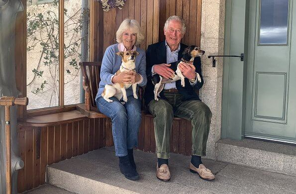Prince Charles, Prince of Wales and the Duchess of Cornwall with Jack Russell terriers Bluebell and Beth